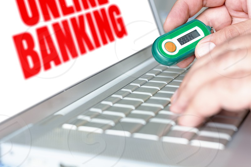 male using a password generator to perform online banking. Security token for banking security. Concept of e-commerce online business and data security photo