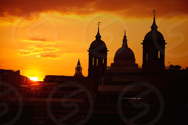 London Bridge sunset at Thames with St Paul Pauls Cathedral photo