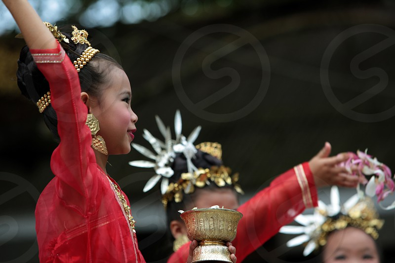 traditional Thai Dance of Aka Women at the Wat Phra That Doi Suthep Temple in the city of chiang mai in the north of Thailand in Southeastasia.  photo