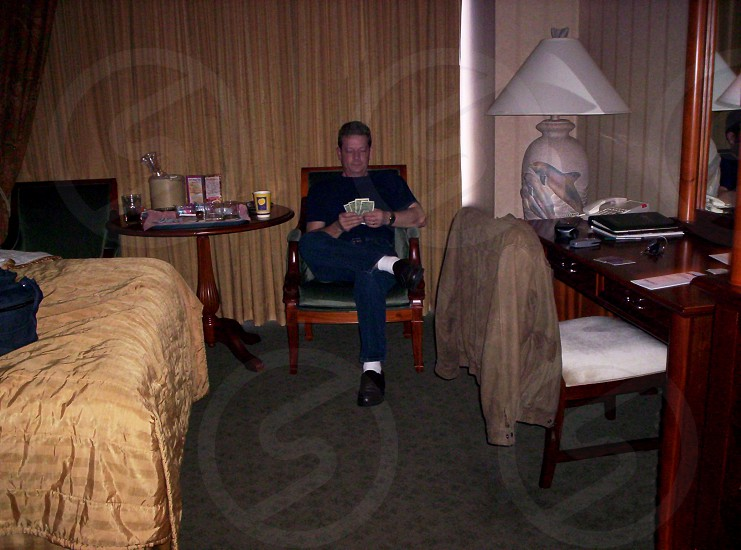 man sitting holding paper photo