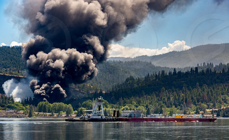 Smolt Barge traveling down river with smoke from Mosier Derailment. photo
