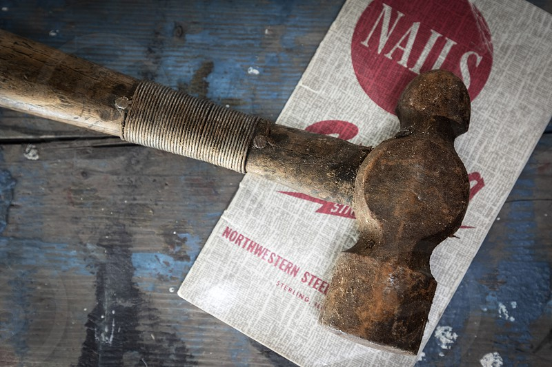 Old hammer with wire repair on handle photo