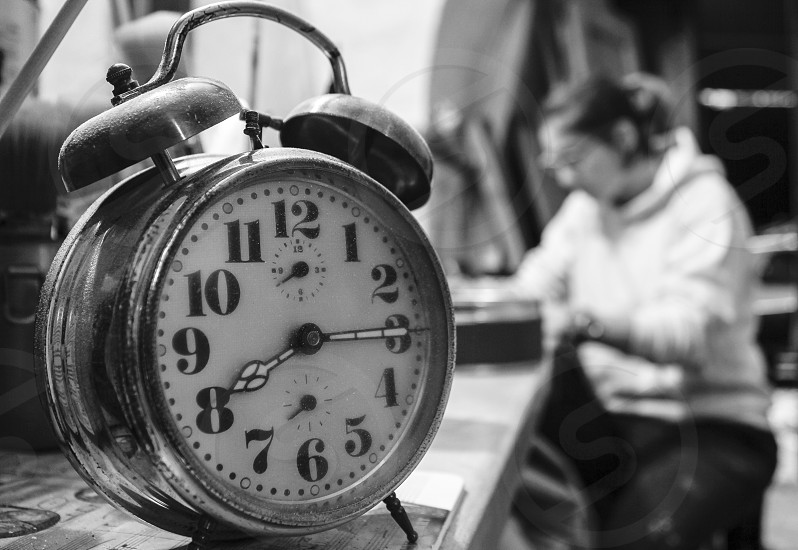 A clock shows the elapsed time during the work day photo