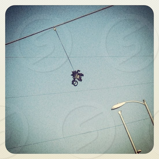 robot hanging from a wire photo