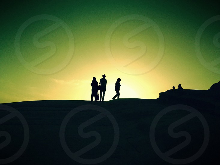 woman silhouette in sunset view photo