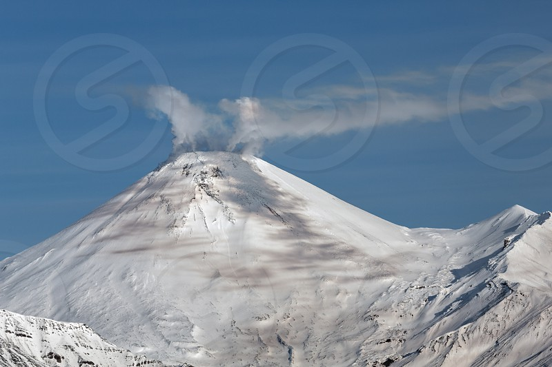 Beautiful volcanic landscape: view of cone Avachinsky Volcano - active volcano of Kamchatka. Koryaksky-Avachinsky Group of Volcanoes Kamchatka Peninsula Russia Far East Eurasia. photo