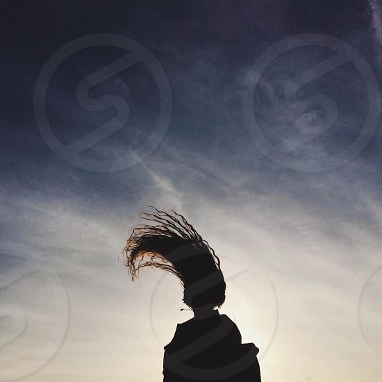 woman silhouette under clear blue sky photo