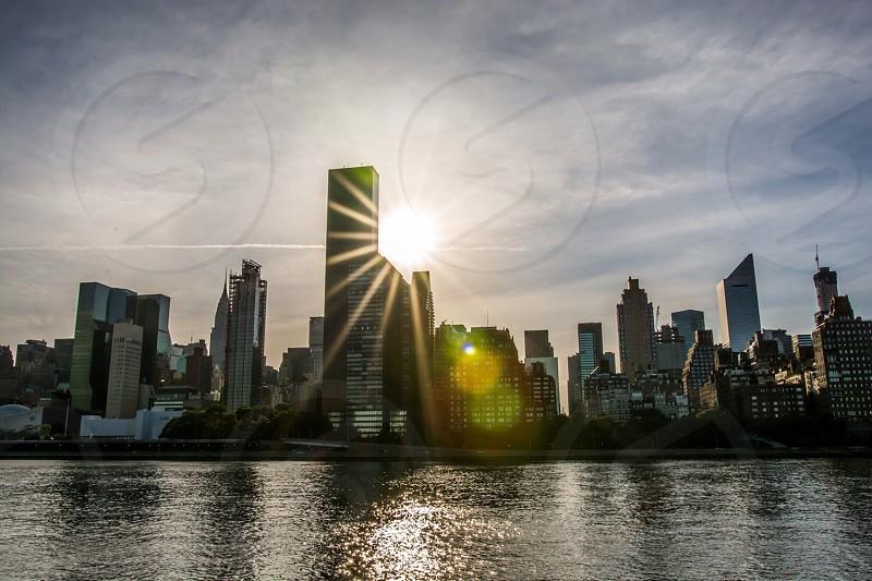"Peeping ""Sun"" over Manhattan New York photo"