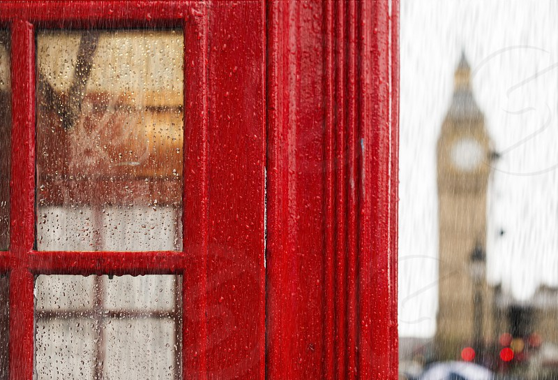 Big ben and red phone cabine in London. Rainy day photo