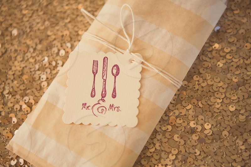 view of mr and mr.s tag on folded fabric photo