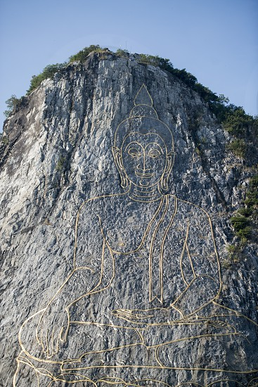the Buddha Cliff of Khao Chee Chan at the village of Sattahip near the city of Pattaya in the Provinz Chonburi in Thailand.  Thailand Pattaya November 2018 photo