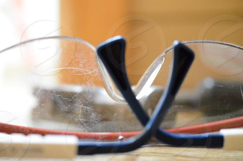 stainless steel hammer behind eye protector glasses photo