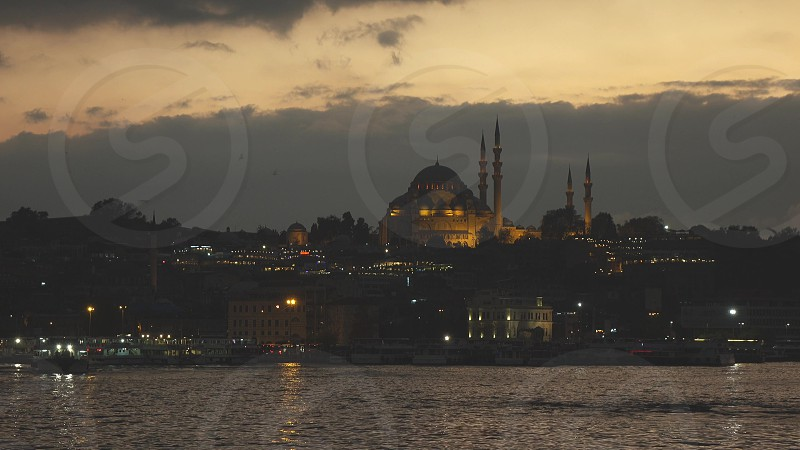 Night view of Eminonu Harbor Beyoglu district historic architecture and Muslim Mosque in Istanbul Turkey on a nightfall sky. 4K UHD video 3840 2160p. photo