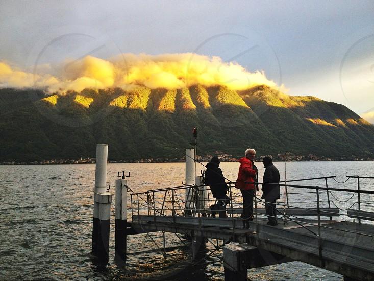 view of a mountain across a lake photo