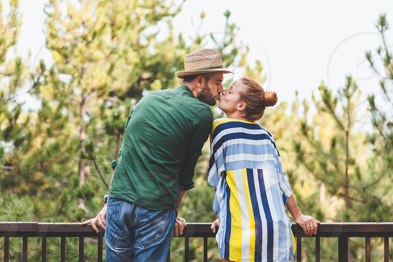Young couple kissing on the balcony photo