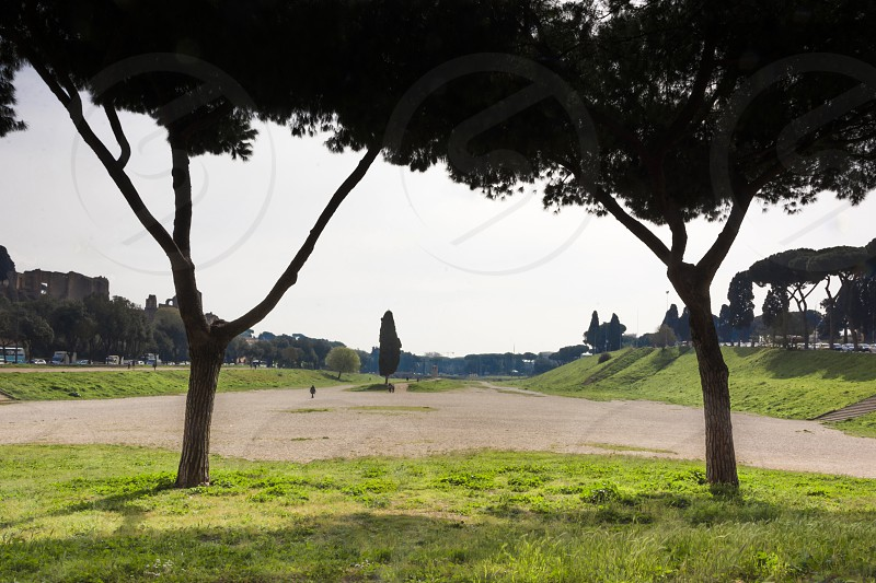 The Circus Maximus is an ancient Roman chariot racing stadium and mass entertainment venue located in Rome Italy. Situated in the valley between the Aventine and Palatine hills it was the first and largest stadium in ancient Rome and its later Empire. It measured 621 m (2037 ft) in length and 118 m (387 ft) in width and could accommodate over 150000 spectators. In its fully developed form it became the model for circuses throughout the Roman Empire. The site is now a public park. photo