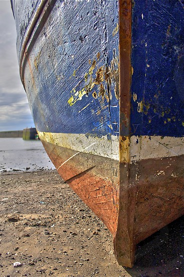Weathered wooden fishing boat on the beach. photo