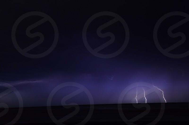 black sky and lightning photo