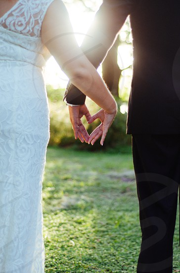 photo of man and woman holding hands photo