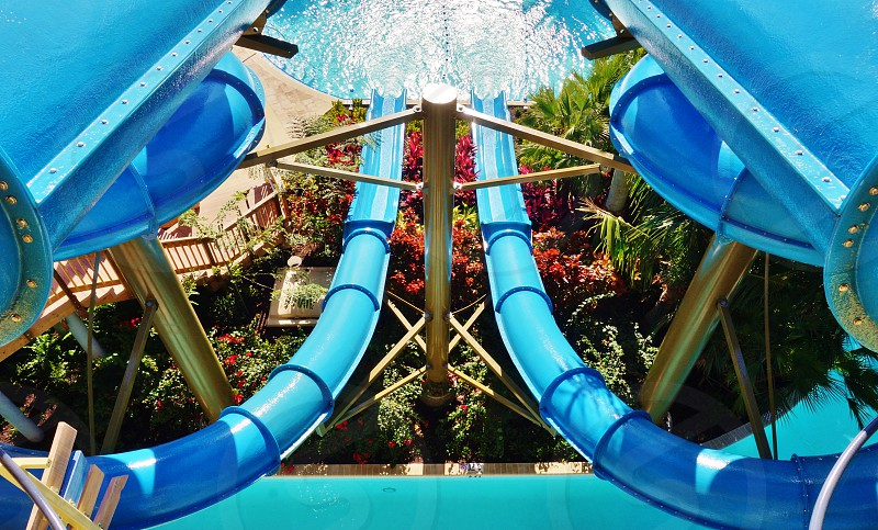 A giant water slide at an outdoor pool photo
