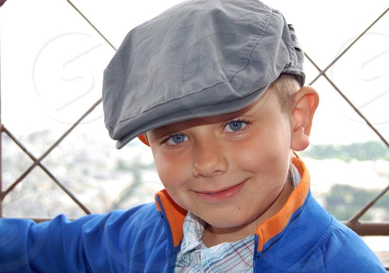 boy wearing grey beret photo