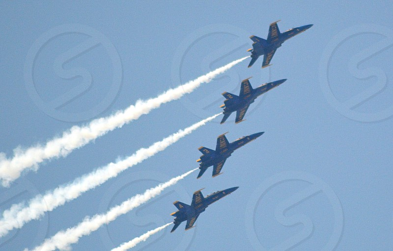 Blue Angels- Trust teamwork precision flight naval aviation air show.  photo