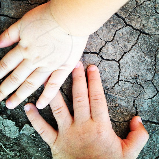 hands children earth ground soil photo