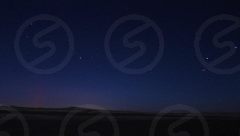 blue starry night sky dark ground photo