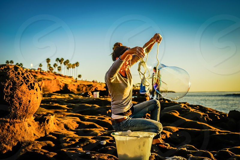 There's nothing that makes you feel like a kid again more than some bubbles!!! Happy Summer!!! photo