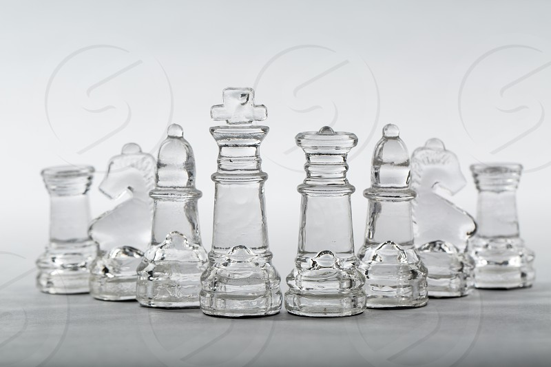 clear glass chess pieces photo