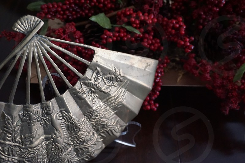 gray oriental  hand fan photo