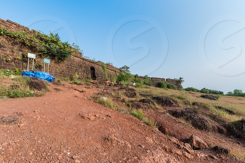 Ruin of Chapora Fort located in Bardez Goa rises high above the Chapora River. The fort changed hands several times after Portuguese acquired Bardez. photo