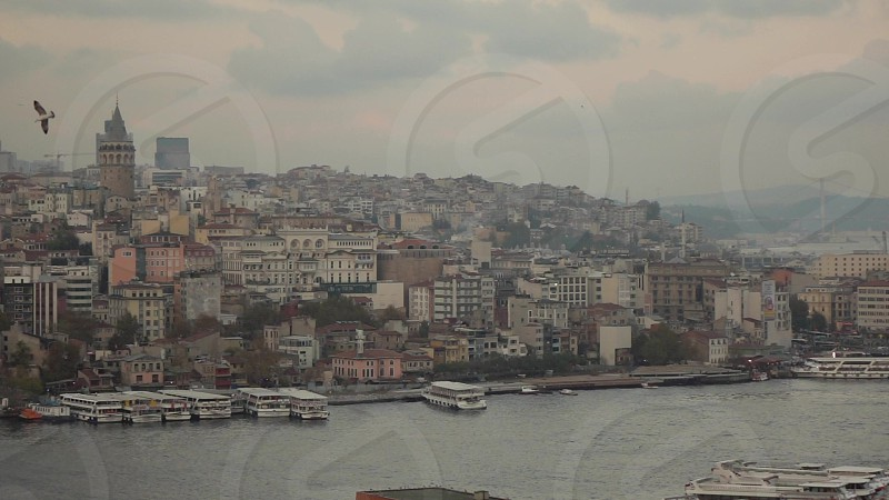 Aerial view of Istanbul old part city Turkey Golden Horn with marine traffic and Galata Tower on a background cloudy sky day time sunny weather. Slow motion Full HD video 240fps 1080p. photo