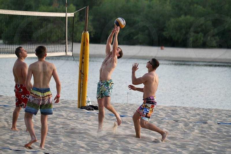 Summer beach volleyball game fun activities guys vacation holiday play  photo