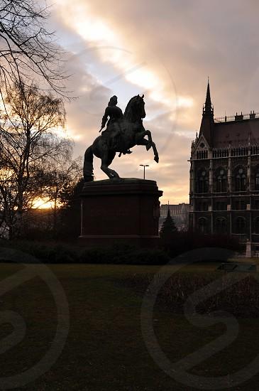 man in horse statue photo