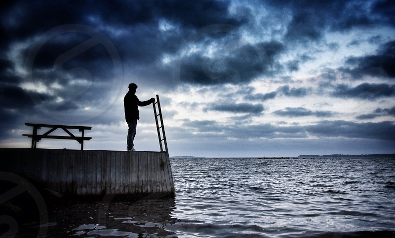 At the sea silhouette ladder water man Sweden photo