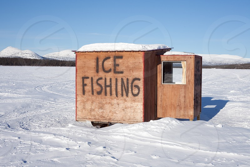 This little shack is on skids and can be moved to a favorite fishing spot on Fish Lake Yukon Territory Canada photo