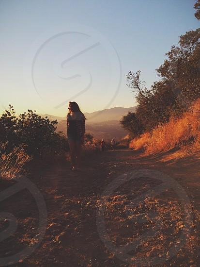 woman walking on loam soil ground photo