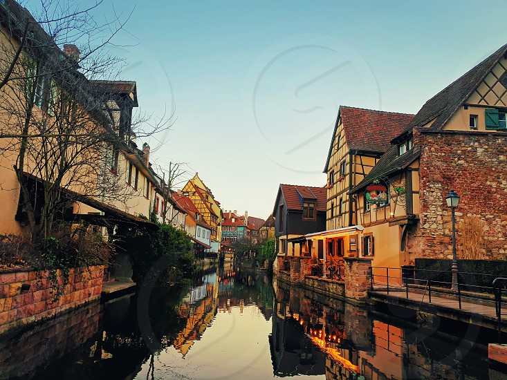 Autumn evening in colorful romantic city Colmar France Alsace. Traditional houses near the river. Medieval home facade historic town. Beautiful idyllic architecture. photo
