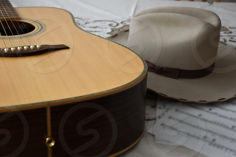 Guitar and cowboy hat photo