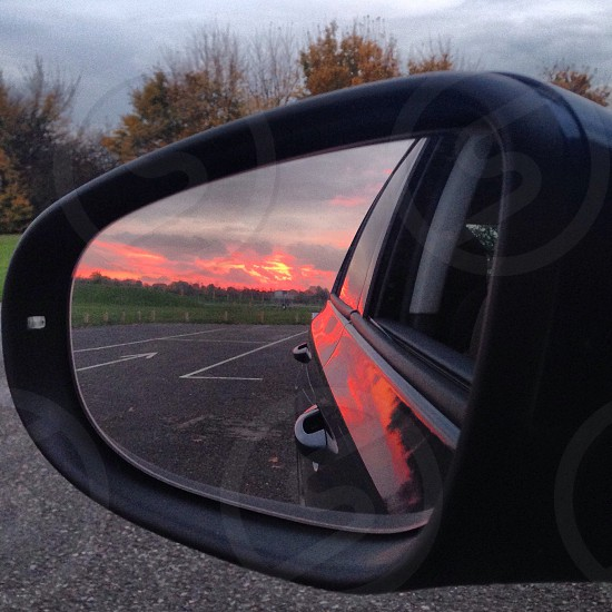 The sunset at the iconic Dorney Olympic Rowing Lake reflected in a VW Golf wing mirror.  photo