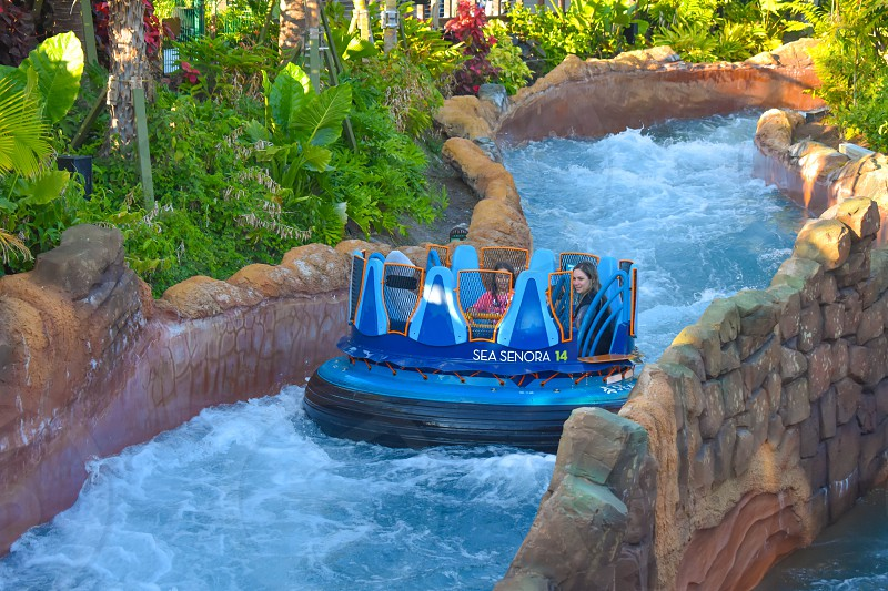 Orlando Florida. January 20 2019 People enjoying river attraction ride Infinity Falls at Seaworld Marine Theme Park (2) photo