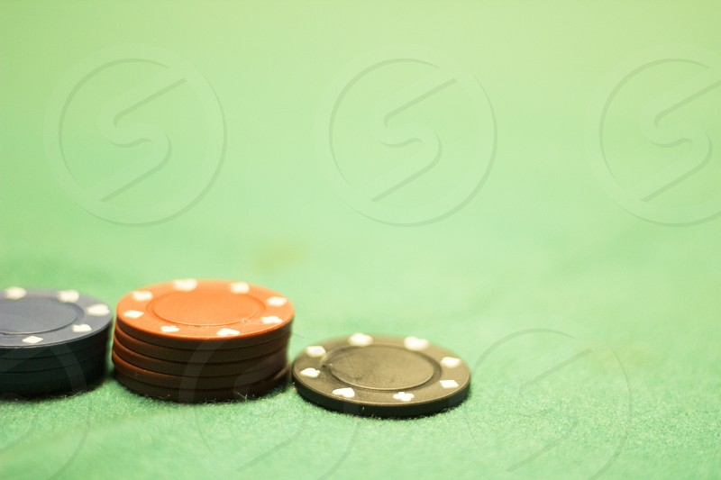 close up of some poker gambling chips photo