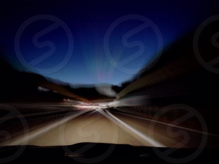 blury road at night photo