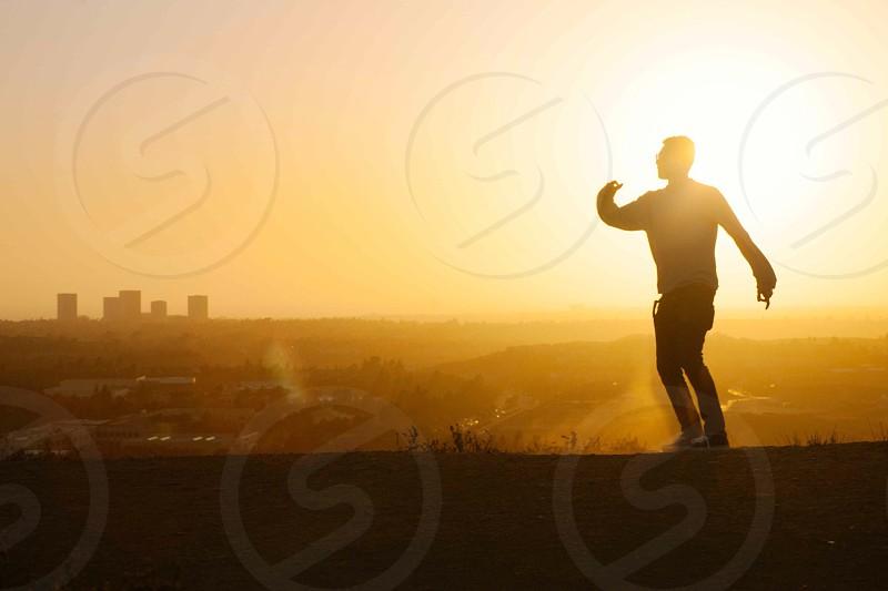 man running under sunrise photograph photo
