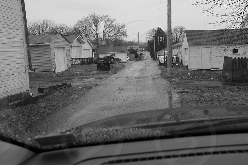 Rainy day in a small towns back alleyway. photo