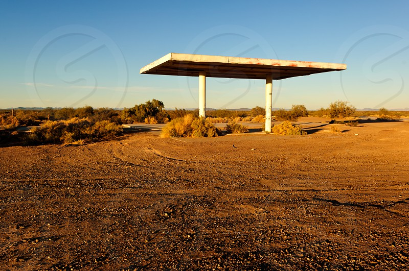The ghostly remains of a long abandoned gas station that burned down decades ago in the little town of Aztec Arizona. photo