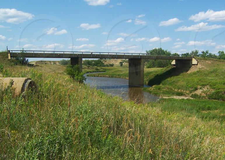 outdoor view of gray concrete bridgeway photo