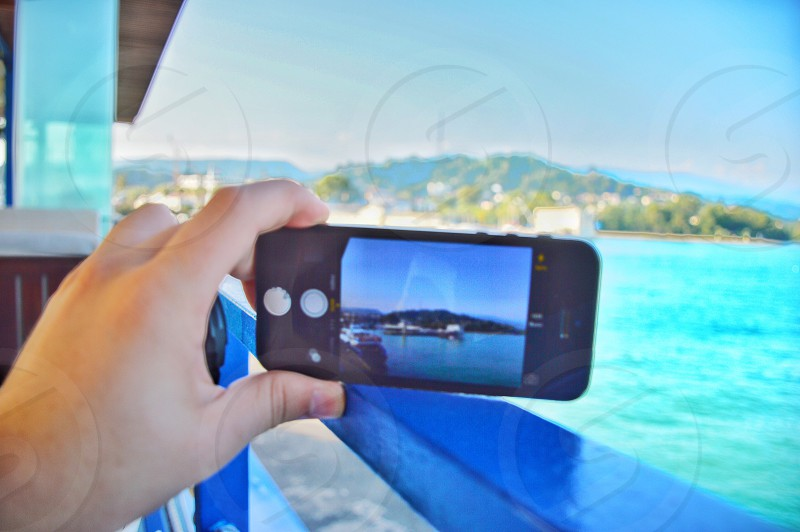 human taking a photo on sea photo