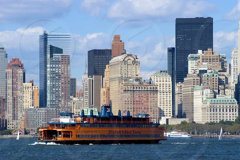 orange boat on ocean photo